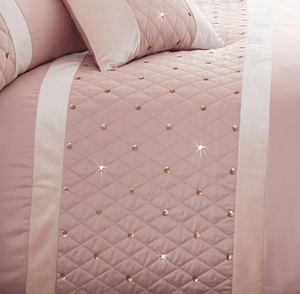 Quilted border with sequin embellishment creates an elegant look