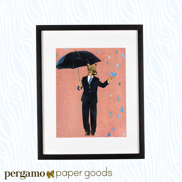 Framed art of a fox holding an umbrella and wearing a suit. Rain drops are falling on a pink background. The illustration is fun and playful.