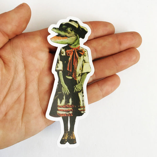 Hand holding a retro alligator vinyl sticker