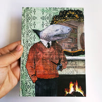 Hand holding handmade shark greeting card. Dressed up animals, illustrated greeting card, illustrated animal card
