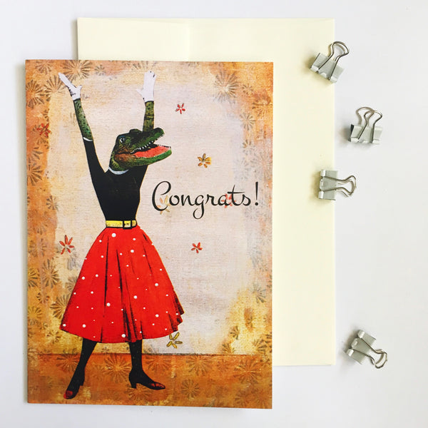 "Vintage illustration of a dressed up alligator, arms in the air, with a red polka dot skirt. Text says ""Congrats!"" Pergamo Paper Goods"