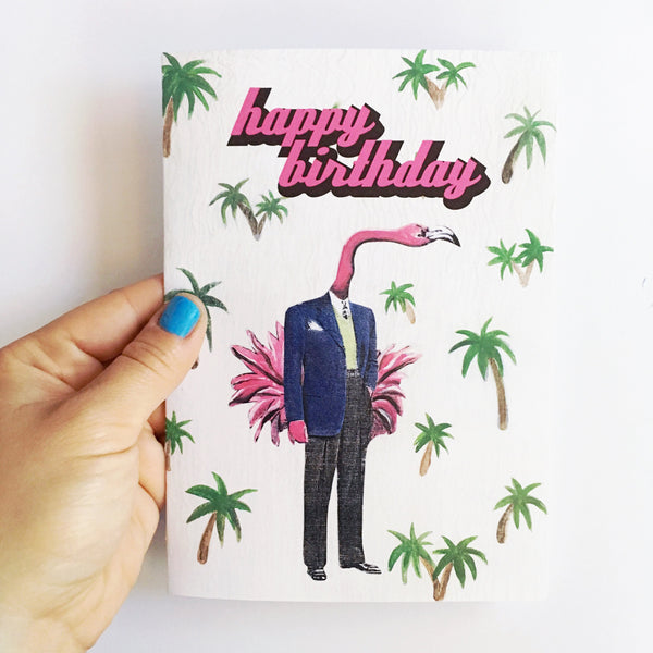 hand holding retro men's greeting card. Flamingo illustration, flamingo dressed in suit, text says happy birthday