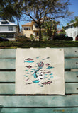 Mermaid Cat Tote Bag hanging over a bench. Handmade illustrated tote