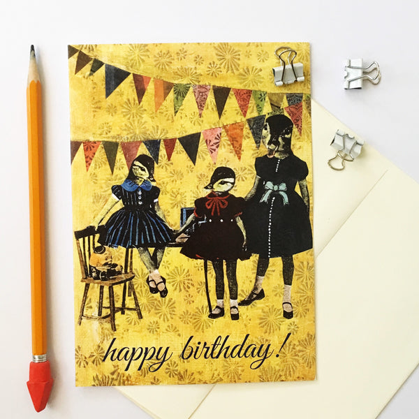 Yellow greeting card photographed with pencil and envelope