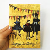 Hand holding vintage inspired greeting card