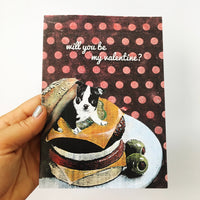 Hand holding a greeting card featuring a boston terrier