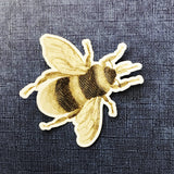 Bee Vinyl Sticker on Blue Background