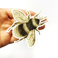 Vintage bee sticker being held