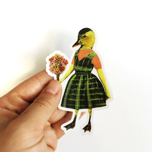 Hand holding duck sticker. Duck wearing dress and holding flowers. Dressed up duck, dressed up animal art, cute animal sticker.