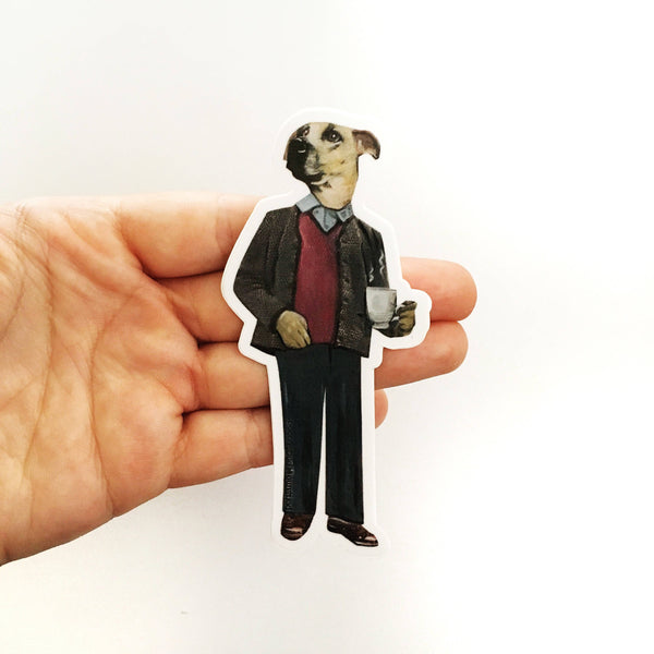 Hand holding illustrated dog vinyl sticker. Retro business casual dog, holding a cup of coffee.