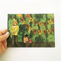 Hand holding birthday card featuring a vintage fox