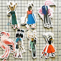 Retro animal stickers on a cutting board. Fancy fox, sassy cat, dapper flamingo, antique flamingo, cute dog, dapper deer, retro alligator stickers