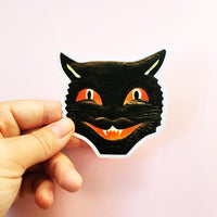 Halloween Vinyl Sticker of a Black Cat Face