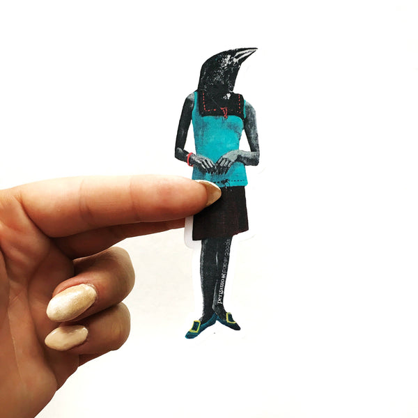 Hand holding a dressed up black crow sticker