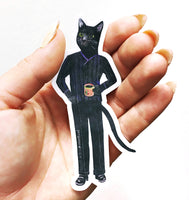 Hand holding a dressed up cat laptop sticker