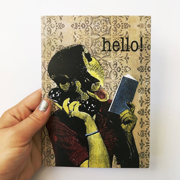 hand holding a retro illustrated card. illustration is duck on the phone. text reads, hello!