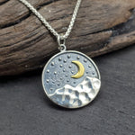 Load image into Gallery viewer, Sterling silver pendant with textured starry sky, mountains and crescent moon landscape