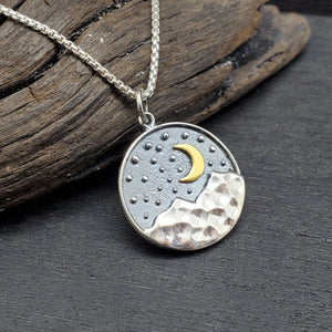 Sterling silver pendant with textured starry sky, mountains and crescent moon landscape