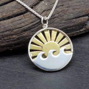 Sterling silver pendant with two tone silver waves and bronze sun with rays