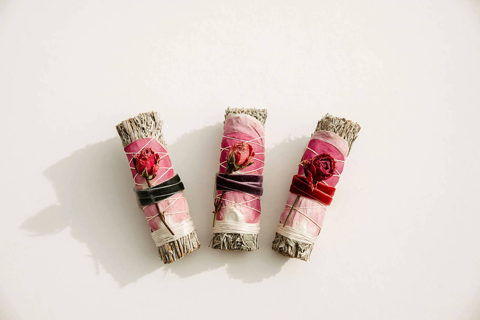 sage and dried rose petals smudge stick