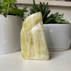 lemon calcite cut base free form