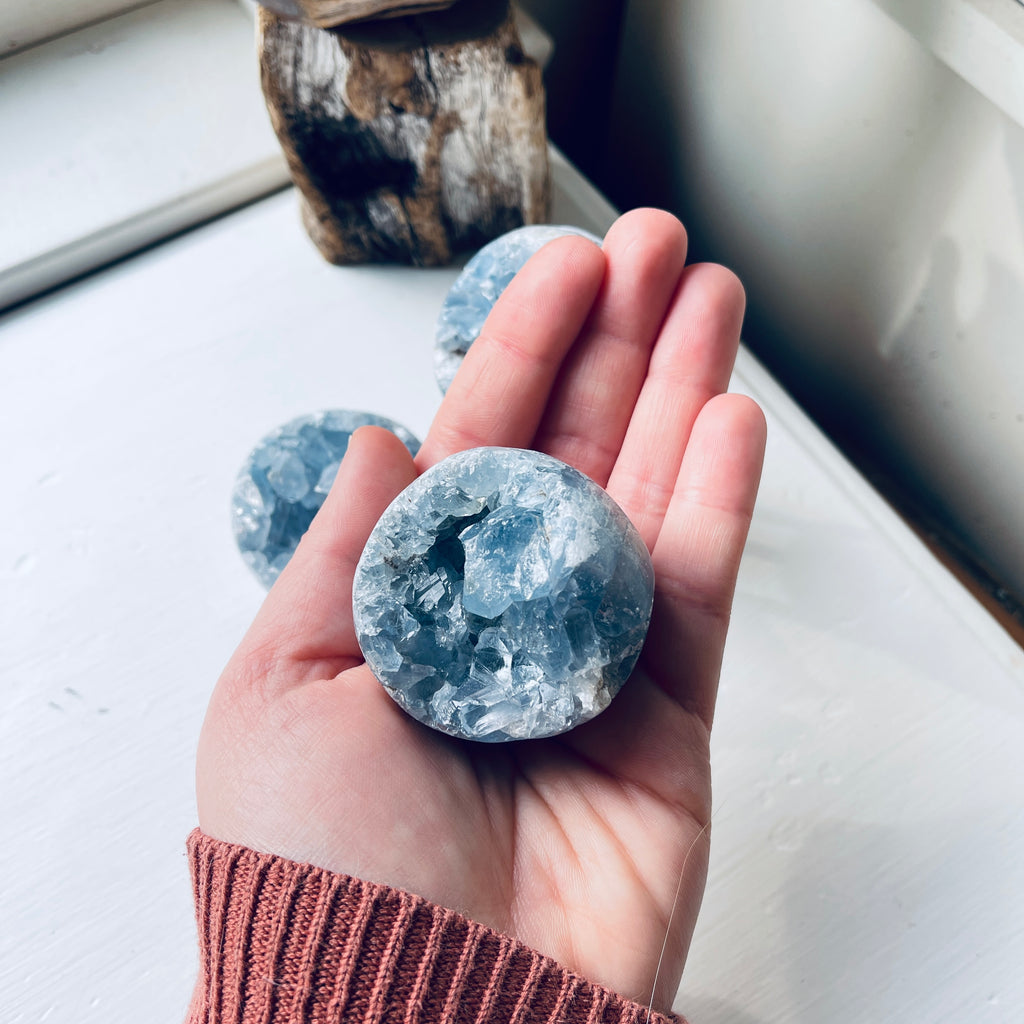 celestite sphere on metal stand