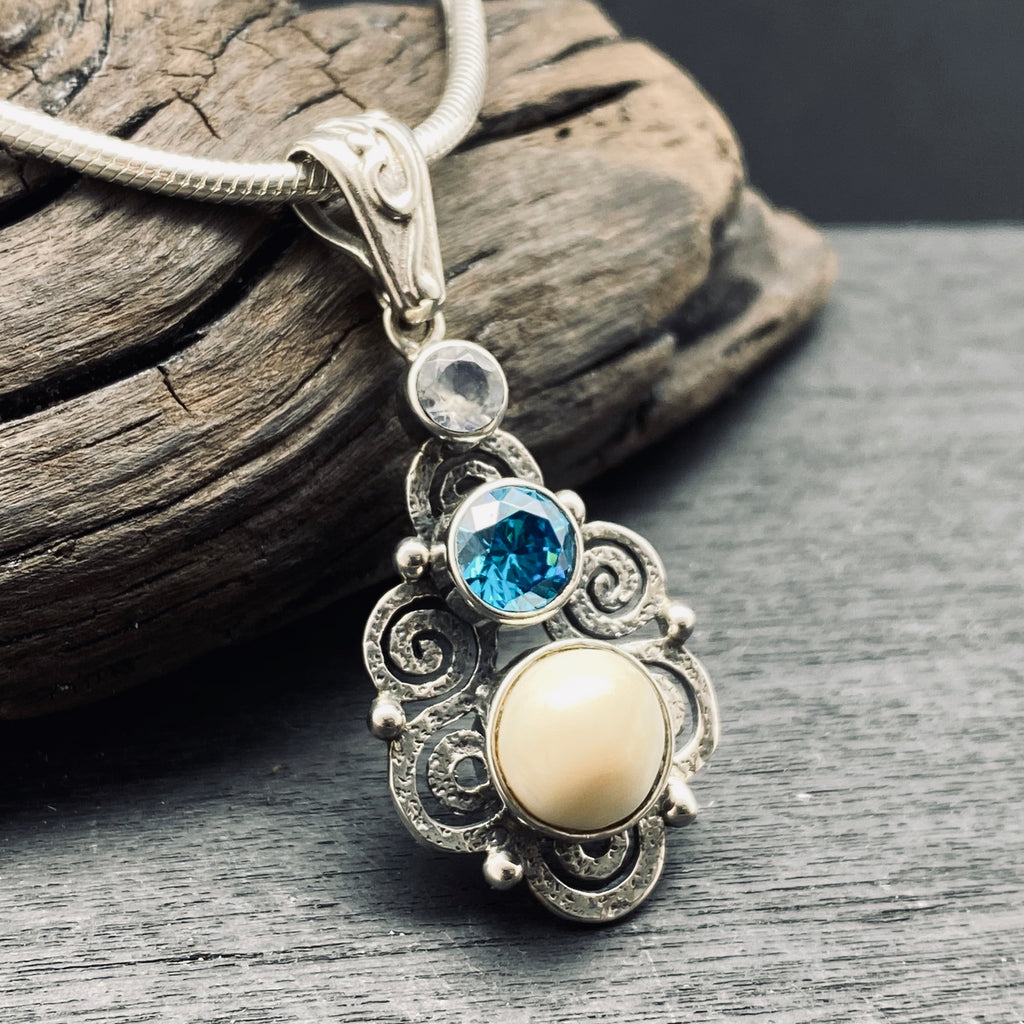 Sterling silver blue topaz spiral necklace