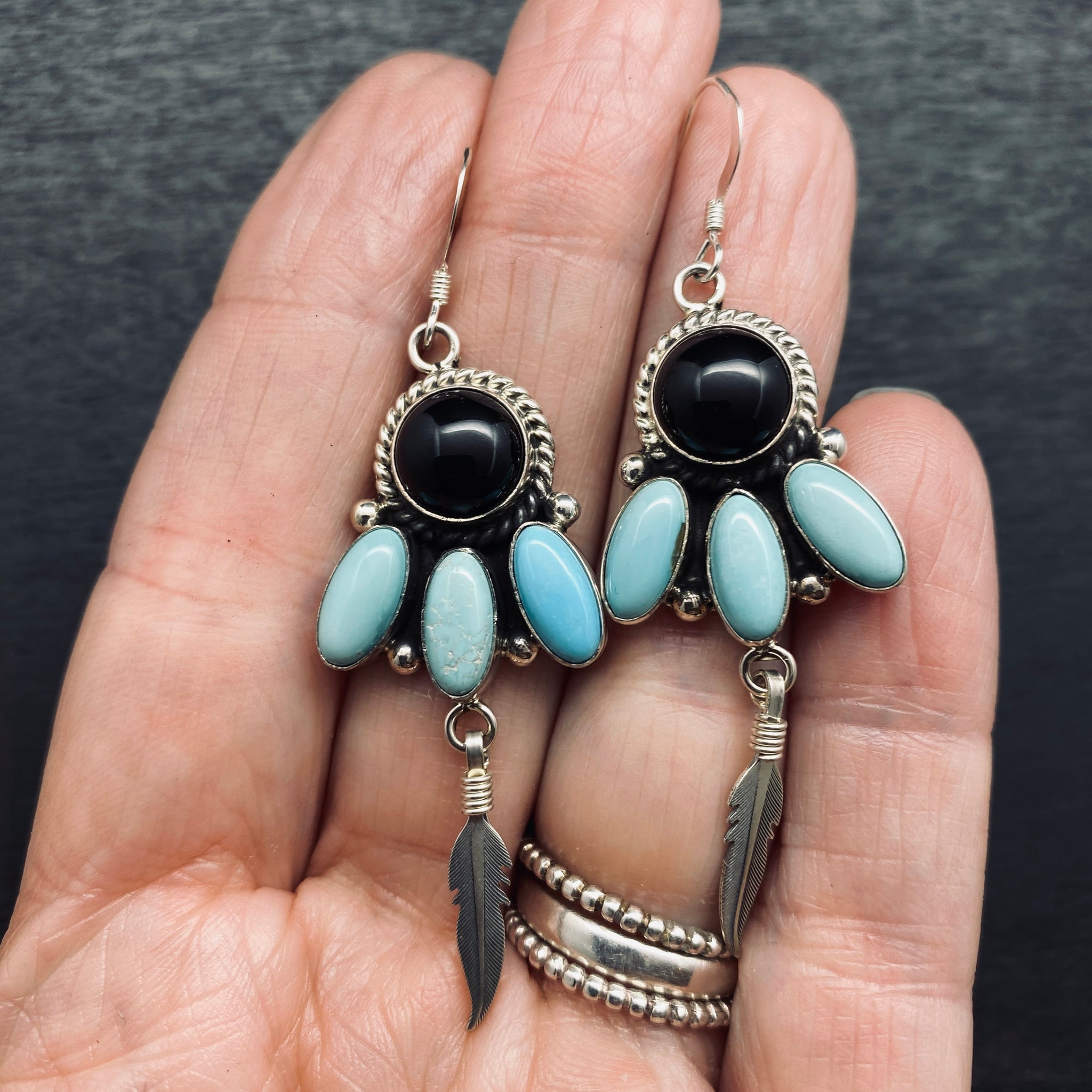 Navajo made sterling silver earrings with turquoise and blank onyx