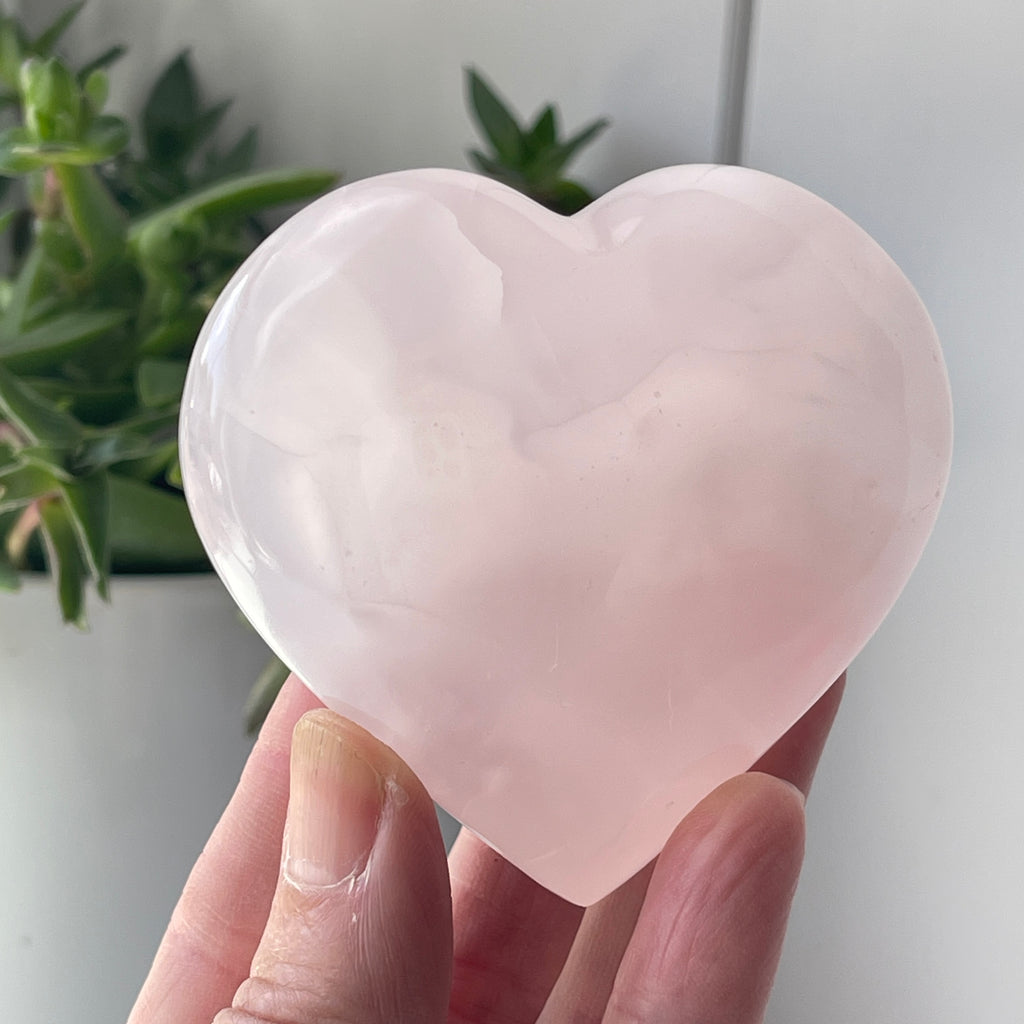 pink mangano calcite stone crystal heart worry stone love