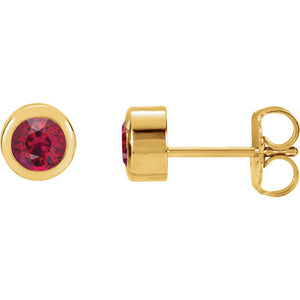 Side View 14 Karat Yellow Gold Bezel Set Ruby Stud Earrings