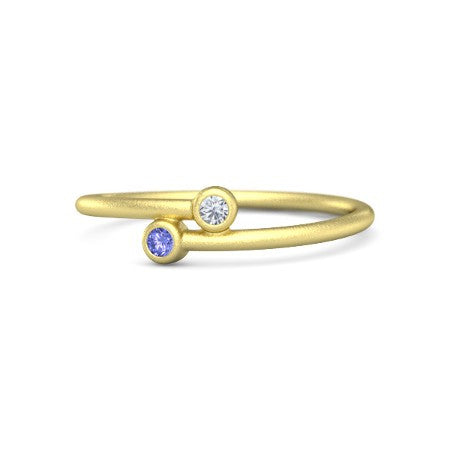 14 Karat Yellow Gold Tanzanite and Diamond Bypass Style Ring