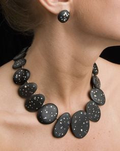 Starry night necklace and earrings on a person