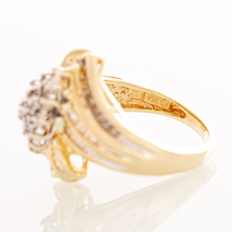 Diamond cluster ring in 10k yellow gold.