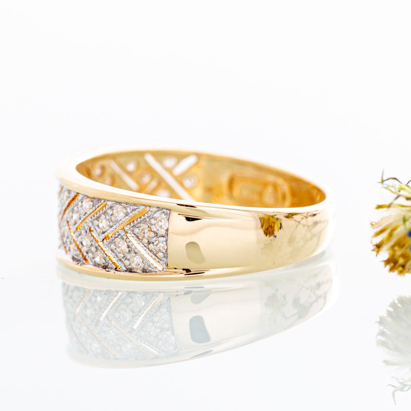 Diamond herringbone band in 14k yellow gold.
