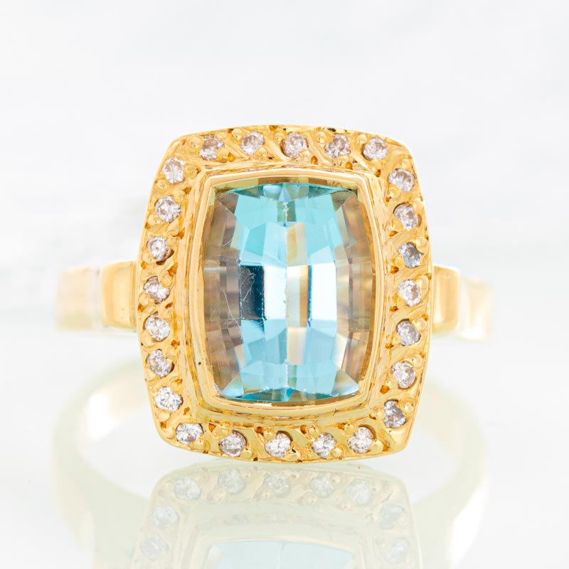 Blue Moon Geometric Aquamarine ring with diamonds in 14k yellow gold.