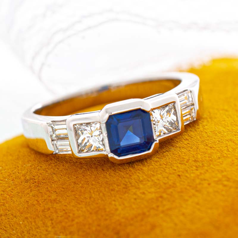 Geometric blue sapphire ring with diamonds in 14k white gold.