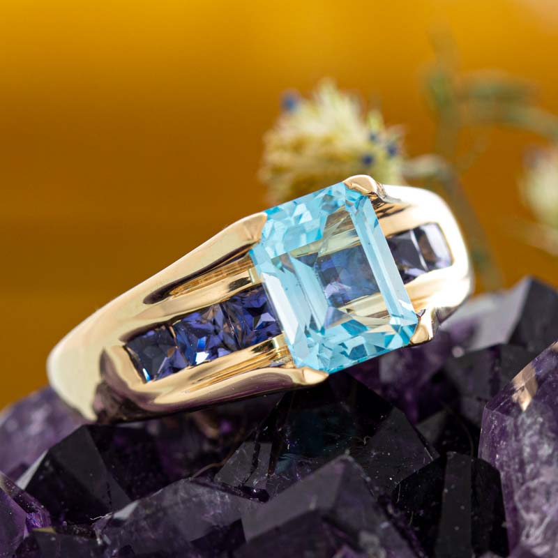 Geometric topaz and amethyst ring in yellow gold.