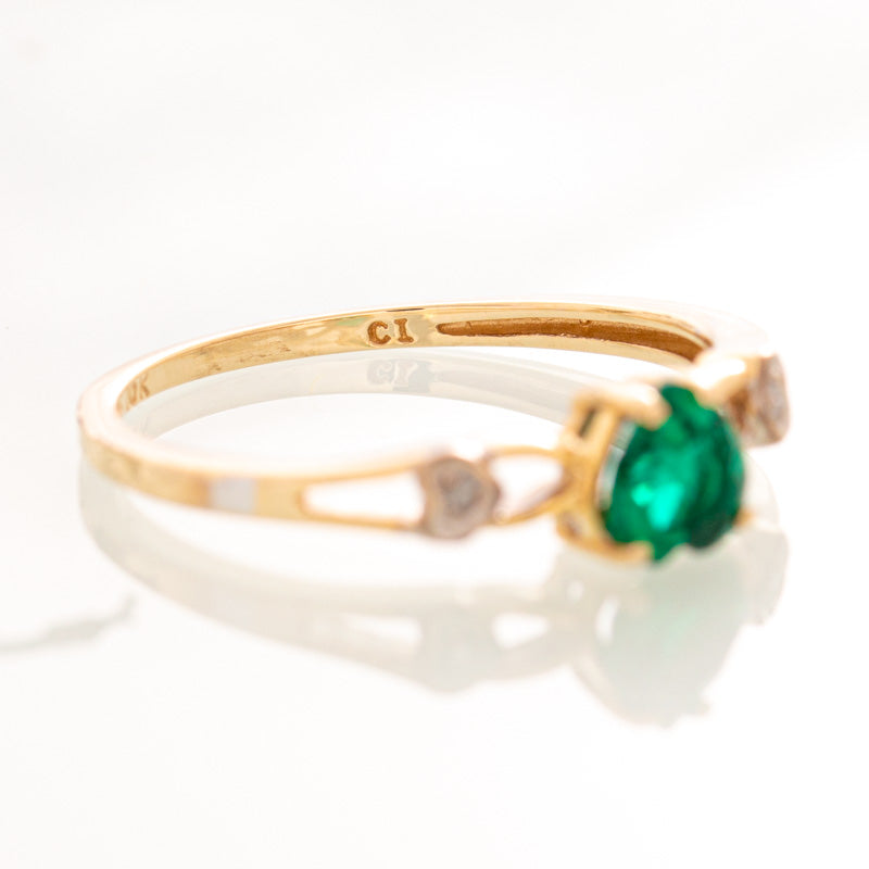 Green lab emerald heart ring with diamonds in 10k yellow gold.
