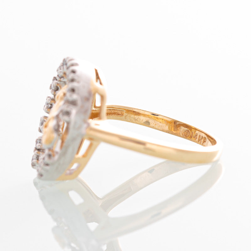Horseshoe diamond ring in 14k yellow gold.