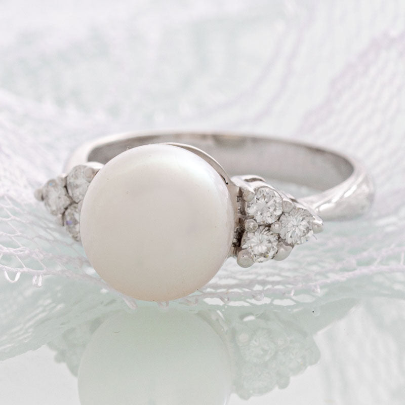 White pearl ring with diamonds in 14k white gold.