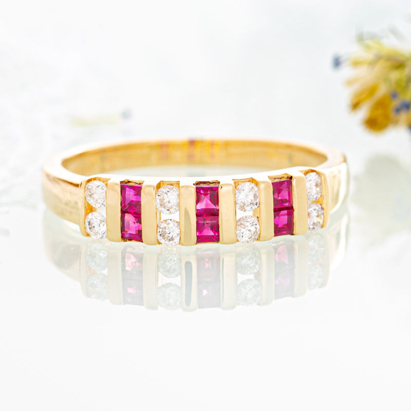 Ruby and diamond stripped ring in 14k yellow gold.
