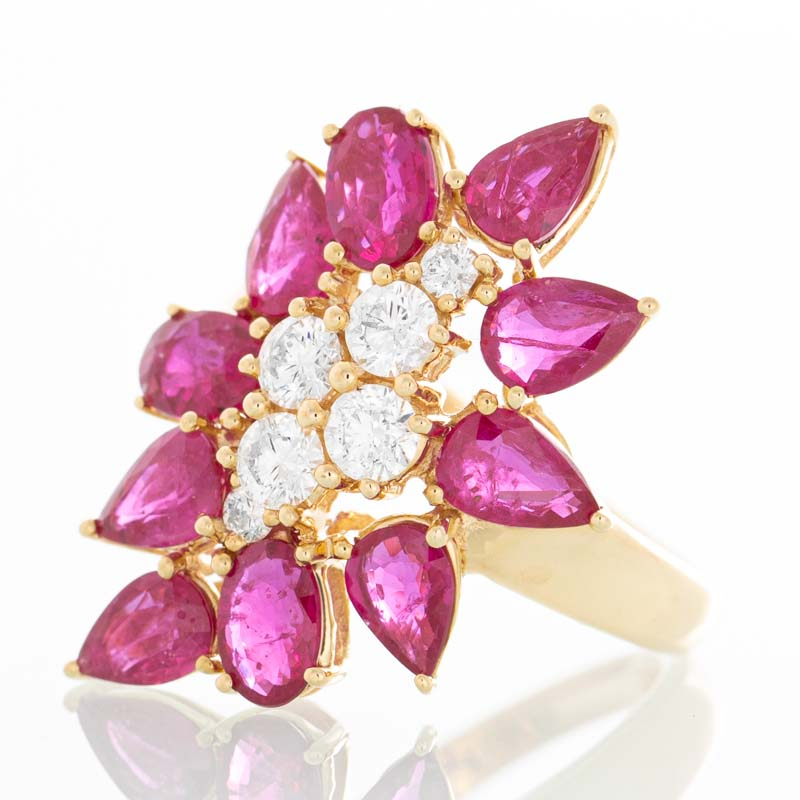 Ruby Petals ring with diamonds in 18k yellow gold.