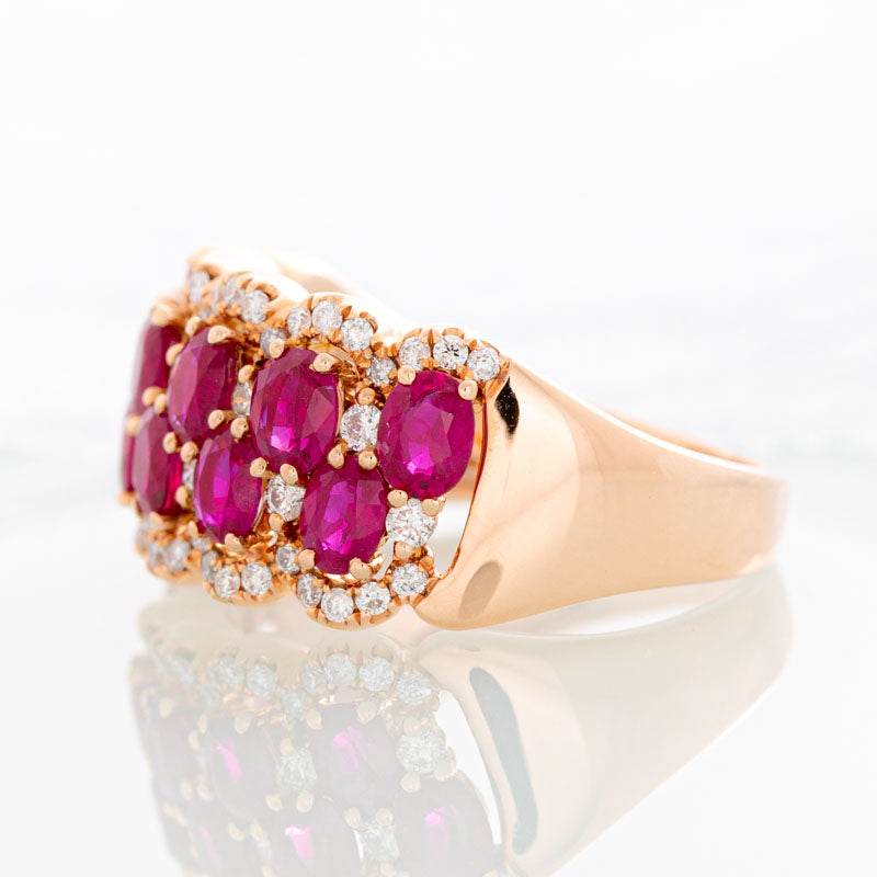Raspberry Wine Ruby Row ring with halo diamonds in 14k rose gold.