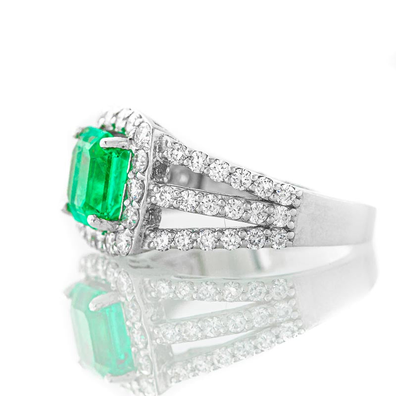 Colombian Emerald Ring with diamond halo in 14k white gold.