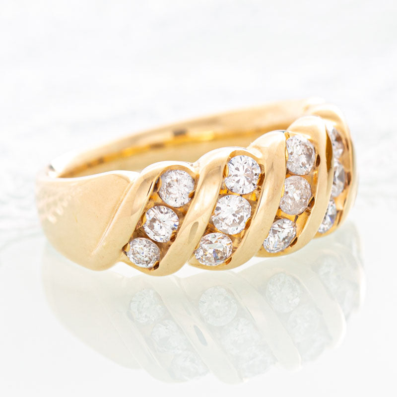 Waves diamond band in 14k yellow gold.