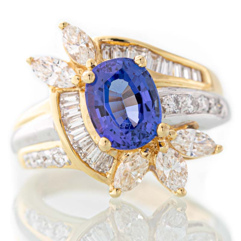 Electric tanzanite and diamond ring in 18k yellow gold and platinum.