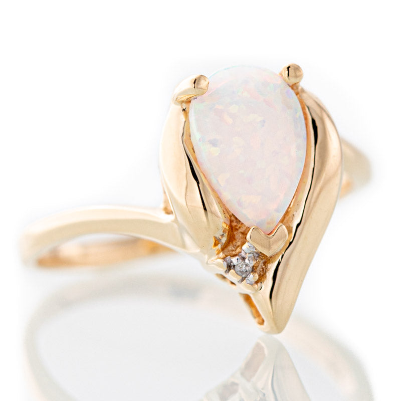 Sarah Pear shape opal ring in 10k gold.