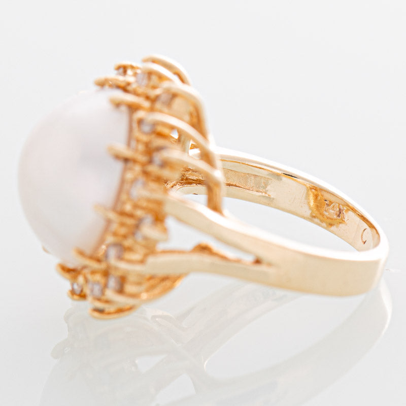 Helios Mabe pearl and diamond ring in 14k gold.