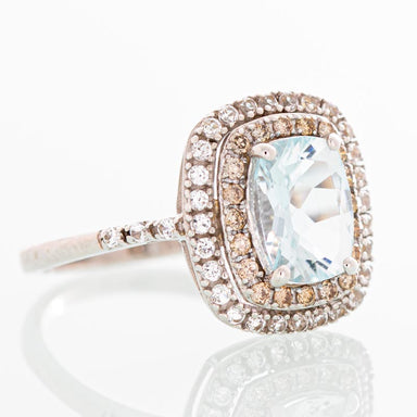 """Pisces"" Aquamarine and diamond halo ring in 14k white gold."