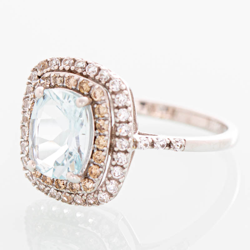 Pisces Lab Aquamarine and diamond halo ring in 14k white gold.